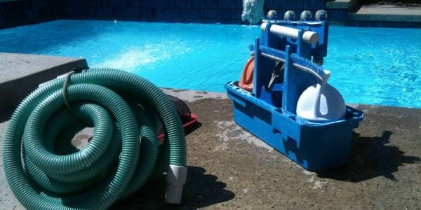 how to vacuum above ground pool